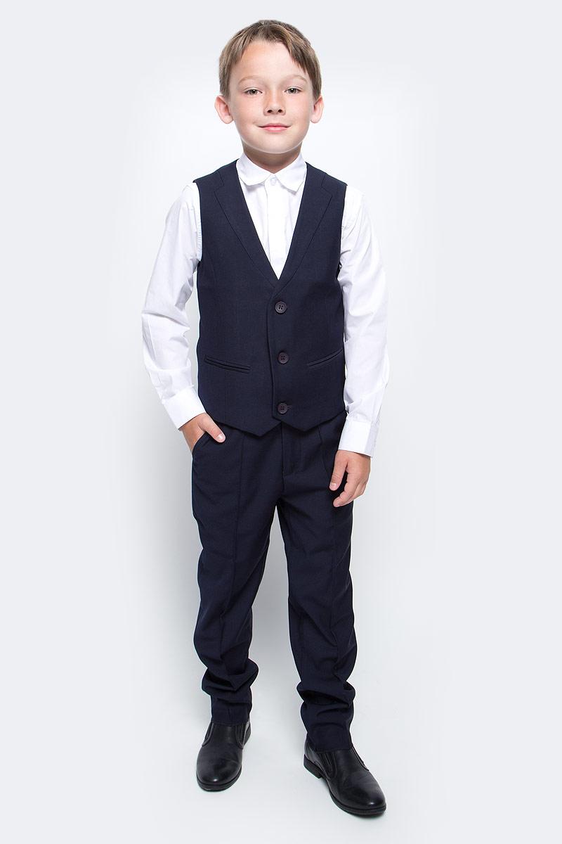 Жилет для мальчика Vitacci, цвет: темно-синий. 1173028-04. Размер 1221173028-04Жилет для мальчика выполнен из хлопка и полиэстера. Модель застегивается на пуговицы.