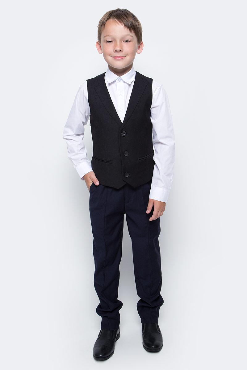 Жилет для мальчика Vitacci, цвет: черный. 1173028-03. Размер 1341173028-03Жилет для мальчика выполнен из хлопка и полиэстера. Модель застегивается на пуговицы.