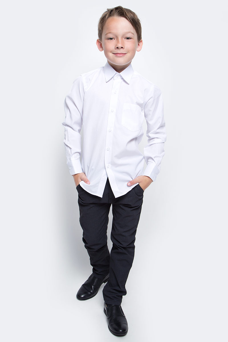 Рубашка для мальчика Nota Bene, цвет: белый. 20581DA01. Размер 12220581DA01Рубашка для мальчика Nota Bene выполнена из высококачественного хлопкового материала. Модель с классическим отложным воротником и длинными рукавами застегивается на пуговицы, на груди дополнена накладным карманом.