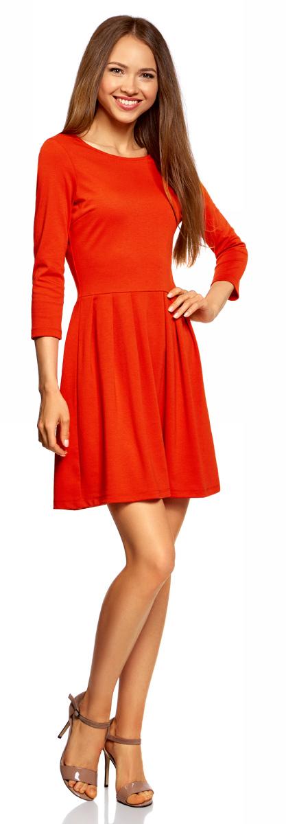 Платье oodji Ultra, цвет: оранжевый. 14011005/38261/5500N. Размер XXL (52)14011005/38261/5500NПриталенное платье oodji Ultra с расклешенной юбкой выгодно подчеркнет достоинства фигуры и поможет создать стильный образ. Модель мини-длины с рукавами 3/4 и вырезом лодочкой выполнена из плотного трикотажа и застегивается на металлическую застежку-молнию на спинке.