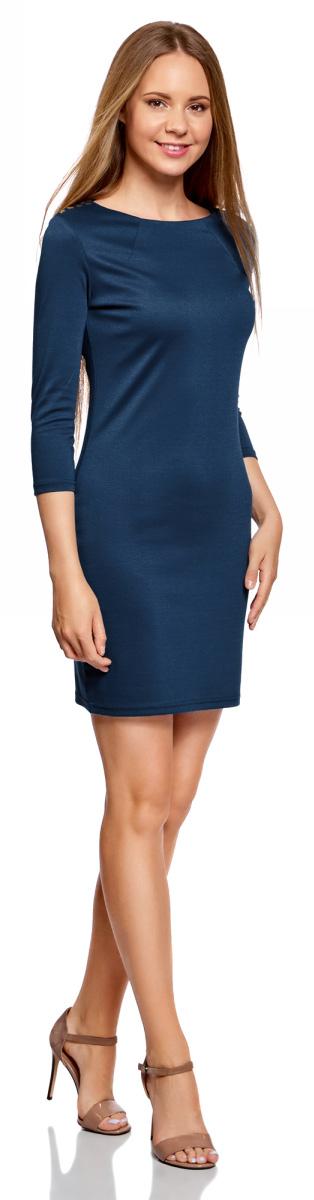 Платье oodji Ultra, цвет: темно-синий. 14001105-2/18610/7901N. Размер L (48)14001105-2/18610/7901NМодное трикотажное платье oodji Ultra станет отличным дополнением к вашему гардеробу. Модель выполнена из полиэстера с добавлением полиуретана. Платье-миди с круглым вырезом горловины и рукавами 3/4 застегивается на металлическую застежку-молнию, расположенную на спинке. В области плеч изделие оформлено металлическими декоративными элементами.