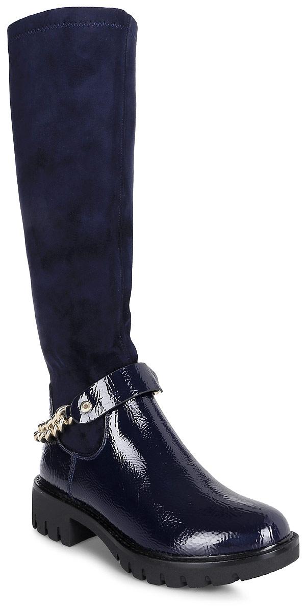 Сапоги женские Vitacci, цвет: темно-синий. 83265. Размер 4083265Стильные женские сапоги от Vitacci займут достойное место в вашем гардеробе. Модель выполнена из качественной искусственной кожи и оформлена декоративной металлической цепочкой. Сапоги застегиваются на молнию. Подкладка и стелька из ворсина защитят ноги от холода и обеспечат комфорт. Умеренной высоты каблук и подошва из термополиуретана с рельефным протектором обеспечивает отличное сцепление на любой поверхности. Модные сапоги займут достойное место среди вашей коллекции обуви.