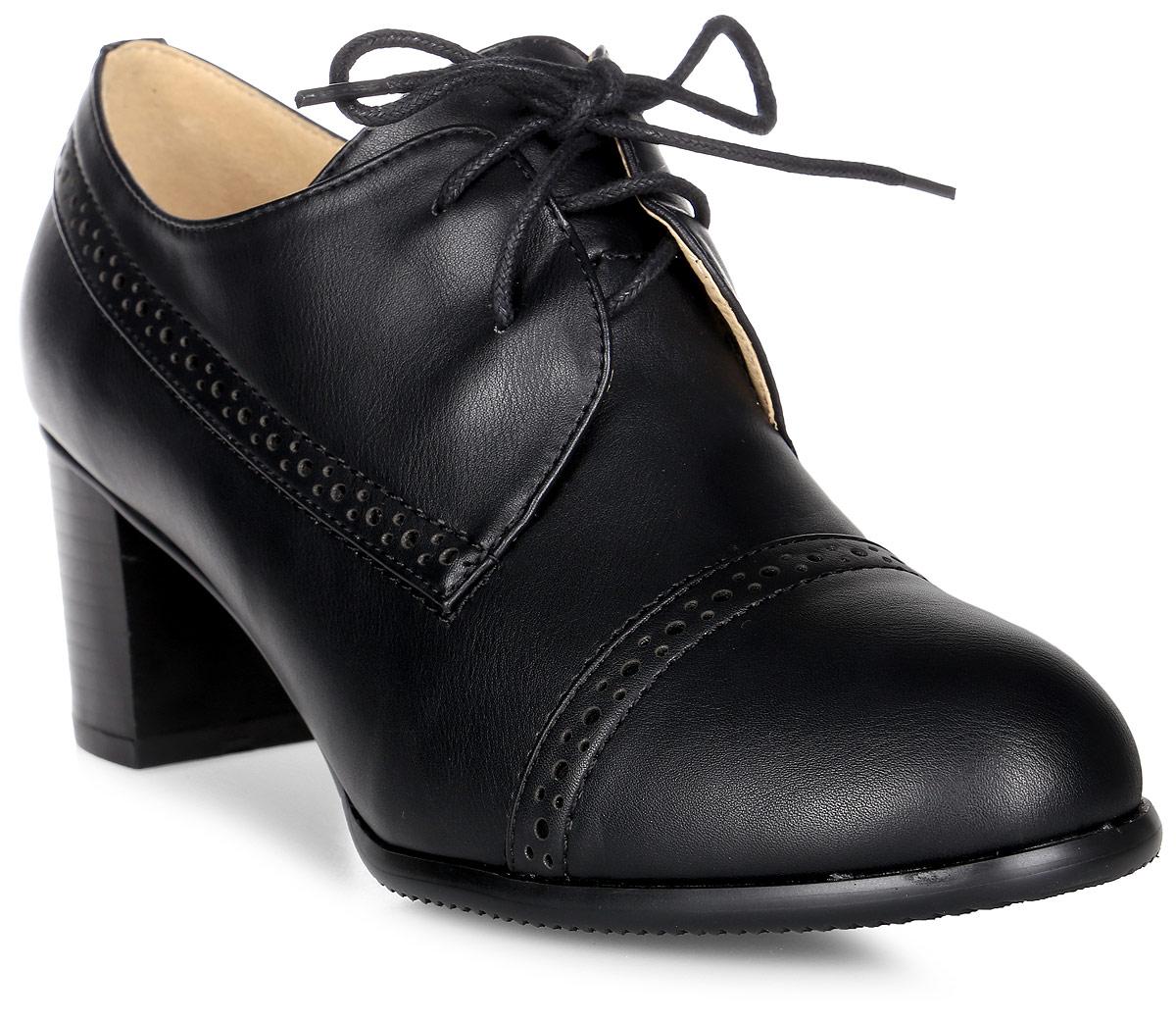 Ботильоны женские Vitacci, цвет: черный. 83508. Размер 3783508Стильные женские ботильоны от Vitacci изготовлены из качественной искусственной кожи. Модель оформлена декоративной перфорацией и удобной шнуровкой. Подошва дополнена устойчивым каблуком.