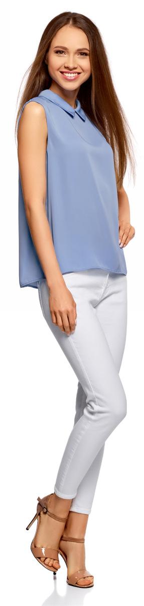 Блузка женская oodji Ultra, цвет: синий. 11411084B/43414/7500N. Размер 36-170 (42-170)11411084B/43414/7500NЛегкая блузка прямого кроя без рукавов с воротником под горло. Особенности этой модели – глубокий вырез-капля с застежкой на крючки на спинке и небольшой округлый отложной воротничок. Блузка прямого силуэта из эластичной ткани отлично сидит и не стесняет движений. Маленькая блузка, по сути топ, – настоящая находка для любителей минимализма в одежде. С ней можно создать множество интересных образов – от строгих деловых до повседневных в стиле casual.