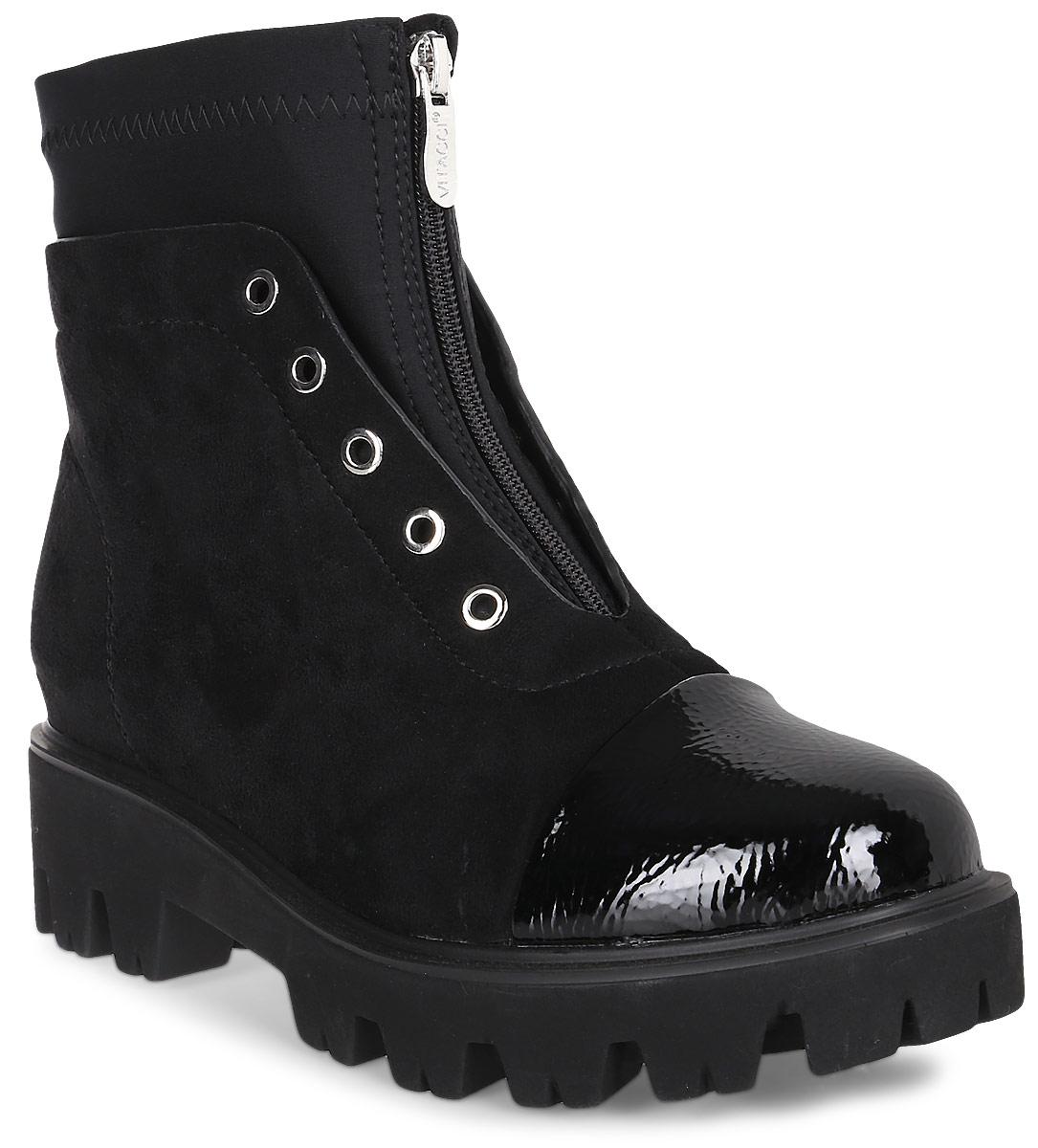 Ботинки женские Vitacci, цвет: черный. 83274-1. Размер 3883274-1Удобные женские ботинки от Vitacci изготовлены из качественной искусственной кожи. Ботинки дополнены декоративной шнуровкой и застежкой-молнией. Практичная стелька из ворсина обеспечит комфорт при носке. Подошва дополнена небольшим каблуком и рифлением.