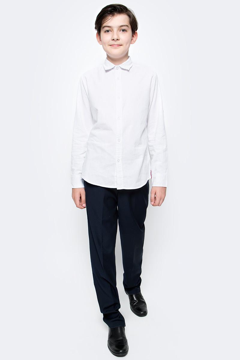 Брюки для мальчика Vitacci, цвет: темно-синий. 1173035М-04. Размер 1641173035М-04Классические школьные брюки выполнены из качественного материала. Модель застегивается на комбинированную застежку, имеются шлевки для ремня.