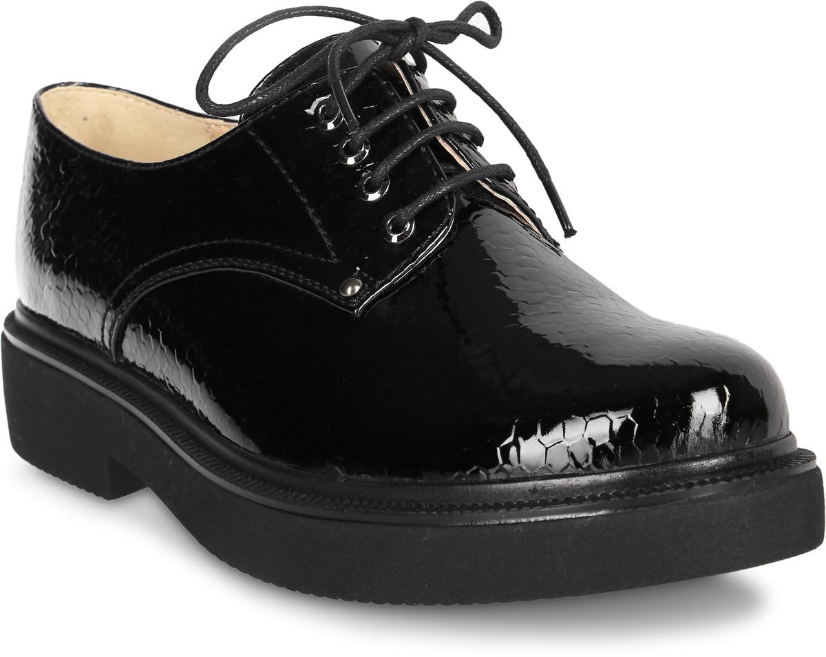 Полуботинки женские Vitacci, цвет: черный. 83345. Размер 3783345Стильные женские полуботинки от Vitacci изготовлены из качественной искусственной кожи. Модель оформлена удобной шнуровкой. Практичная стелька из кожи обеспечит комфорт при носке. Подошва дополнена низким широким каблуком.