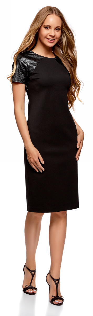Платье oodji Collection, цвет: черный. 24011018-1/43060/2900N. Размер XL (50)24011018-1/43060/2900NЛаконичное платье oodji Collection выполнено из плотного трикотажа со вставками из искусственной кожи с отделкой под рептилию. Модельсредней длины застегивается на скрытую молнию на спинке и дополнена разрезом на юбке. Платье облегающего кроя подчеркивает достоинства фигуры и стройнит ноги. Модель подойдет для офиса, учебы, свидания или встречи с подругами и станет отличным дополнением повседневного гардероба.