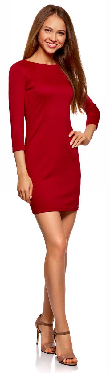 Платье oodji Ultra, цвет: красный. 14001105-2/18610/4500N. Размер L (48)14001105-2/18610/4500NКороткое трикотажное платье приталенного силуэта с эффектным металлическим декором на плечах. Вырез-лодочка акцентирует внимание на линии шеи. Спереди от выреза в стороны отходят две небольшие вытачки. Рукава 3/4 красиво подчеркивают руки. Платье застегивается сзади на короткую молнию, которая выполняет и декоративную функцию. Плотная трикотажная ткань эластична и хорошо тянется, приятно облегает силуэт. Платье отлично сидит и комфортно в ношении. Женственное короткое платье прекрасно подойдет для особенных случаев.