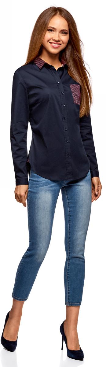 Рубашка женская oodji Ultra, цвет: темно-синий, красный. 11403205-10/26357/7945B. Размер 42-170 (48-170)11403205-10/26357/7945BЭлегантная базовая рубашка с длинным рукавом и отложным воротничком. Модель слегка приталенного силуэта, с закругленным низом. Рубашка застегивается на пуговицы, на груди есть накладной карман. Такая рубашка хорошо смотрится на любой фигуре и подходит для разных погодных условий. Классическая базовая рубашка поможет вам создать стильные и сдержанные деловые образы. Эта рубашка незаменима для офисного гардероба и официальных мероприятий. Ее можно носить навыпуск или заправленной. Можно дополнить рубашку классическими брюками и стильным жилетом – и у вас готов строгий и изысканный комплект на каждый день. Выбор обуви зависит от ваших предпочтений. Это могут быть туфли-лодочки, балетки или ботинки на плоской подошве. Стильная рубашка займет достойное место в вашем гардеробе!