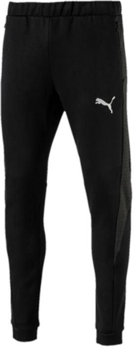 Брюки спортивные мужские Puma Evostripe Ultimate Pants, цвет: черный. 59262301. Размер L (48/50)59262301Модель декорирована ярким серебристым светоотражающим логотипом PUMA, нанесенным методом термопечати, и изготовлена с использованием высокофункциональной технологии warmCell, которая благодаря «дышащим» свойствам материала удерживает тепло и сохраняет оптимальную температуру вашего тела даже в холодную погоду. Пояс и манжеты из собственного материала изделия посажены на эластичную подкладку. Пояс также и снабжен внутренними затягивающимися шнурами, обеспечивающими отличную посадку по фигуре. Скрытые в боковых швах карманы на молнии вместительны и удобны. Фасон в обтяжку по фигуре очень элегантен.