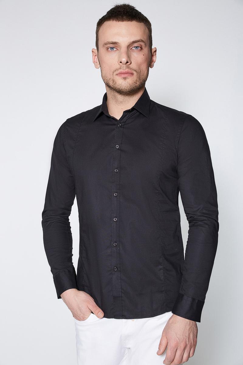Рубашка мужская Sonny Bono, цвет: черный. 60100280002. Размер XL (52)60100280002Классическая рубашка зауженного кроя Sonny Bono выполнена из эластичного хлопкового поплина. Модель с отложным воротником, длинными рукавами с манжетами на пуговицах, застежкой на пуговицы спереди, вытачкой и закругленным низом сзади.
