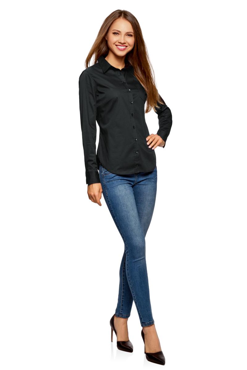 Рубашка женская oodji Ultra, цвет: черный. 11403205-9/26357/2900N. Размер 34-170 (40-170)11403205-9/26357/2900NБазовая рубашка с длинным рукавом и классическим воротником. Застежка на пуговицы, на груди накладной карман. Рукава с манжетами на пуговицах. Вытачки на спине формируют приталенный силуэт, низ рубашки изящно закруглен. Ткань из хлопка с небольшим добавлением эластана комфортна для тела и практична в ношении: дышит, не вызывает раздражений, быстро сохнет после стирки. Рубашка прекрасно сидит на любой фигуре и отлично смотрится. Классическая базовая рубашка удачно впишется в деловой и повседневный гардероб. Такая рубашка незаменима для офисных комплектов, сдержанных и строгих образов. Она хорошо сочетается с классическими прямыми и зауженными брюками, джинсами. Сверху комплект с рубашкой можно дополнить жакетом или жилетом. Из обуви к комплекту с рубашкой можно подобрать туфли, ботильоны, сапоги или ботинки на плоской подошве. Универсальная рубашка на каждый день!