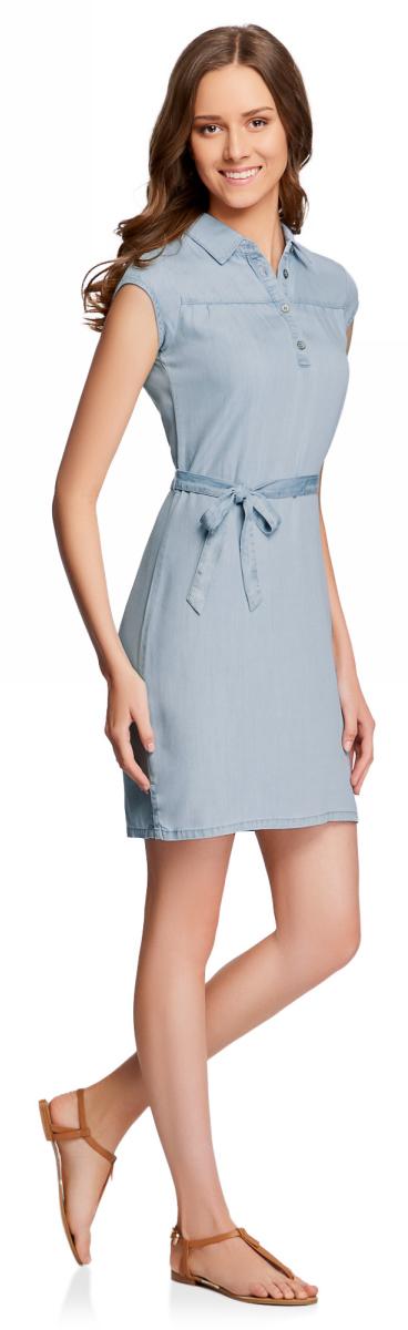 Платье женское oodji Collection, цвет: голубой, джинс. 22909022-1/42579/7000W. Размер 36-170 (42-170)22909022-1/42579/7000WПлатье прямого силуэта с короткими рукавами и поясом. От кокетки чуть присборено. Классический отложной воротничок, застежка спереди на четыре пуговицы. Короткие рукава полностью открывают руки. Платье длиной до середины колена визуально стройнит, небольшие разрезы по бокам удобны при ходьбе. Поясок из той же ткани, что и платье, обеспечивает идеальную посадку: вы сможете подогнать платье в талии под свою фигуру и по своему вкусу. Ткань из древесного целлюлозного волокна является разновидностью вискозы и обладает прекрасными характеристиками: гладкая, мягкая и шелковистая на ощупь. Она прекрасно впитывает влагу, дышит и гипоаллергенна. Женственное платье прекрасно подойдет для создания повседневных луков. В нем можно отправиться на прогулку, свидание, встречу с друзьями. Достаточно дополнить платье соответствующими аксессуарами и обувью – и стильный лук на все случаи жизни готов! Это платье органично впишется в гардероб молодой девушки!