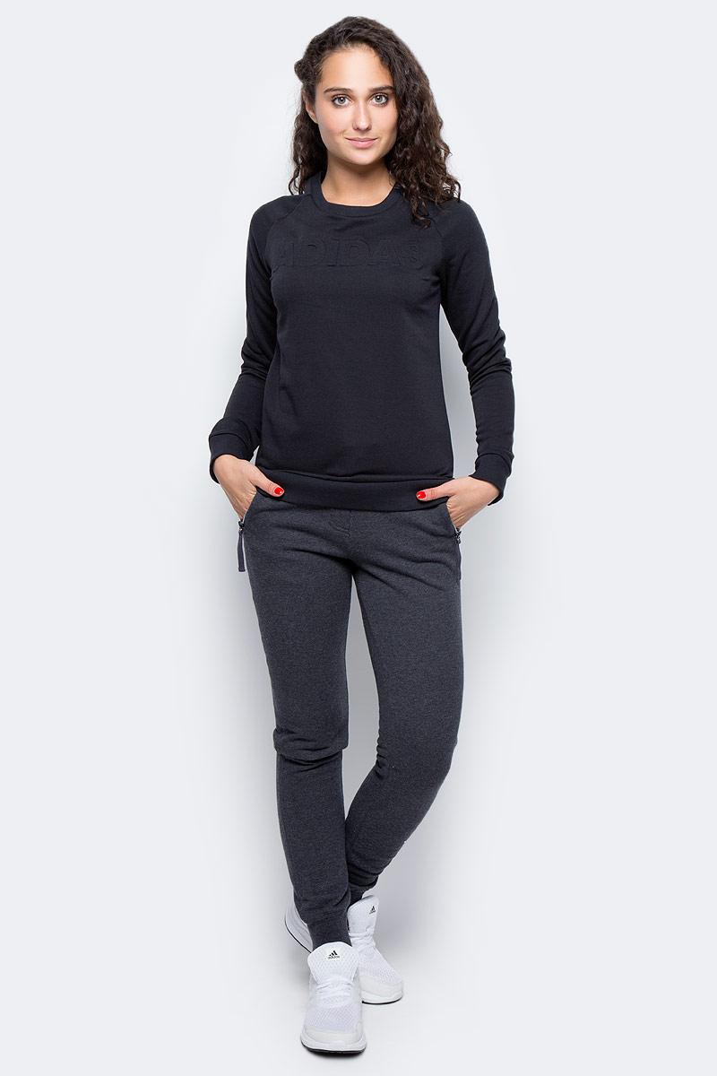 Толстовка женская Adidas Lineage Sweater, цвет: черный. CD1940. Размер S (42/44)CD1940Женская толстовка Adidas изготовлена из хлопка с добавлением полиэстера. Модель с круглым вырезом горловины и длинными рукавами, дополнена тисненной надписью на груди. . Рукава реглан обеспечивают свободу движений. Рифленые манжеты и нижний край удерживают модель на месте.