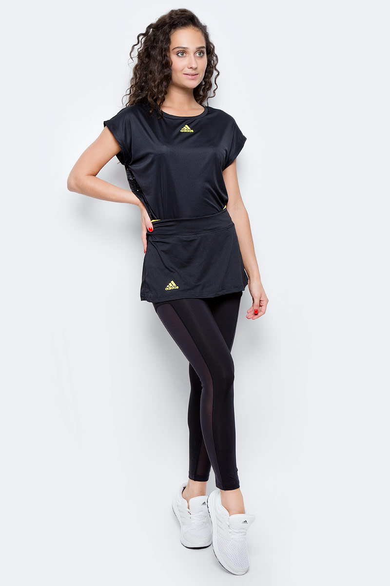 Юбка-тайтсы 2 в 1 для тенниса женская Adidas Us Series Leg, цвет: черный. BP9394. Размер L (48/50)BP9394Женская юбка - тайтсы Adidas выполнена из высококачественного материала. Леггинсы укороченной длины,дополнены сетчатыми вставками по бокам,для повышенной вентиляции. Юбка украшена контрастной вставкой по верхнему краю пояса. Эластичный тонкий трикотаж, облегающий крой и широкий пояс подчеркивают изящность фигуры. Технология climacool® эффективно отводит излишки влаги, сохраняя чувство свежести на протяжении всего дня.