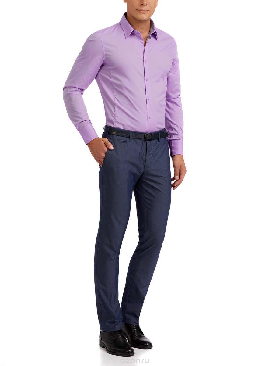 Рубашка мужская oodji Basic, цвет: сиреневый. 3B140000M/34146N/8000N. Размер 39 (46-182)3B140000M/34146N/8000NМужская рубашка oodji Basic изготовлена из хлопка с добавлением полиамида и эластана. Классический воротничок с острыми углами, манжеты с пуговицами, застежка на пуговицы спереди по всей длине. У рубашки слега приталенный силуэт, ее можно носить заправленной или навыпуск. Оптимальное соотношение хлопка и синтетики: не мнется, прекрасно держит форму и дает коже возможность дышать. В такой рубашке комфортно в течение всего дня. Элегантная рубашка станет основой для делового гардероба. Она хорошо сочетается с прямыми и зауженными брюками. Для создания строгого образа рубашку можно дополнить классическим или спортивным пиджаком, или же в качестве второго слоя выбрать трикотажный кардиган. С этой рубашкой вы можете создать разные деловые луки. Они всегда будут отвечать строгому дресс-коду. Из обуви предпочтение рекомендуется отдавать классическим моделям туфель.
