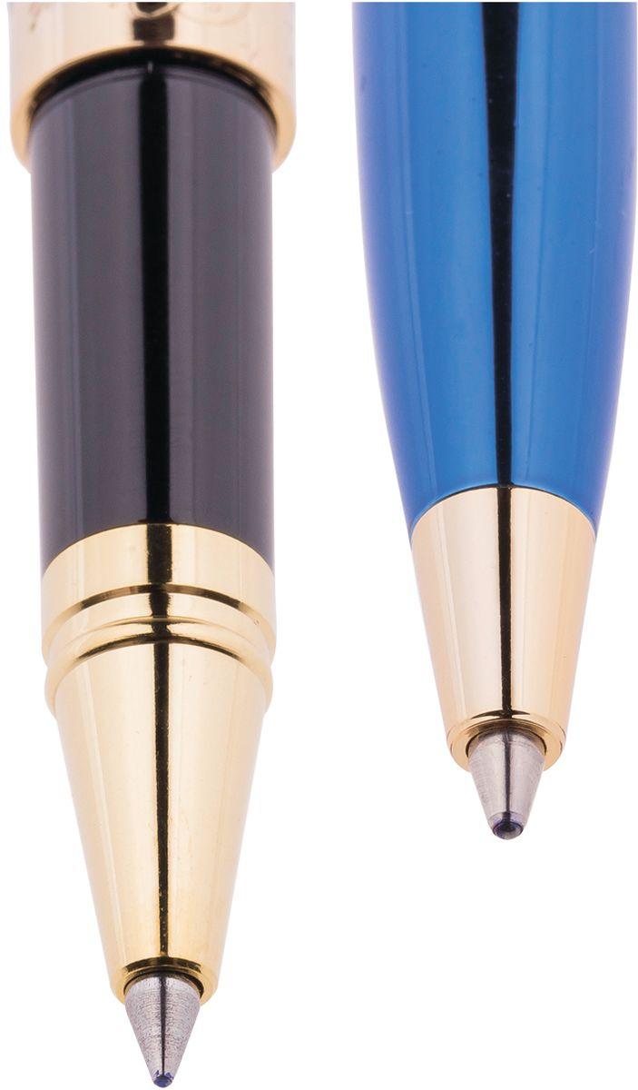 Набор ручек Delucci - это идеальный подарочный набор в подарок деловому человеку: шариковая ручка, диаметр пишущего узла - 1,0 мм и ручка-роллер, диаметр пишущего узла - 0,6 мм. Цвет корпуса сине-золотистый. Орнамент в полоску. Изящная гравировка.