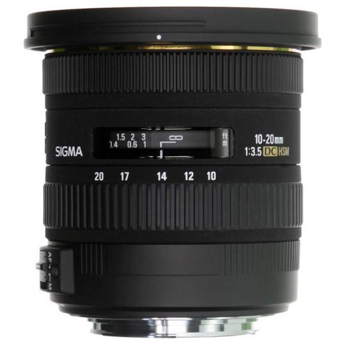 Sigma AF 10-20mm F3.5 EX DC HSM, Nikon311954Двукратный сверхширокоугольный объектив Sigma AF 10-20 mm F/3.5 EX DC HSM открывает отличные возможности широкоугольной съемки как в помещении, так и на открытом воздухе. Даже с учетом кроп-фактора его диапазон фокусных расстояний охватывает наиболее употребительные широкоугольные значения 15 – 30 мм. Высокая постоянная светосила дает возможность с удобством использовать объектив в пасмурную погоду или для съемки в помещении. Угол поля зрения изменяется в пределах 102,4° - 63,8° (в зависимости от исполнения), что позволяет получать преувеличенную перспективу и с успехом решать самые сложные творческие задачи. Объектив AF 10-20 mm F/3.5 EX DC HSM специально предназначен для использования с цифровыми камерами и формирует круг изображения, в точности соответствующий площади сенсора формата APS-C. Уменьшение круга изображения позволило сделать объектив более легким и компактным, благодаря чему AF 10-20 mm F/3.5 EX DC HSM сможет с удобством отправиться со своим владельцем в любую поездку или путешествие. Объектив принадлежит к линейке профессиональной оптики Sigma EX, поэтому весьма надежен в эксплуатации и имеет очень прочную конструкцию.Используемые технологииDC - Компактные и легкие объективы для цифровых камер.HSM - Ультразвуковой моторный привод (Hyper Sonic Motor) обеспечивает быструю и бесшумную фокусировку.