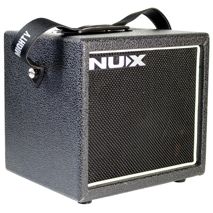Nux Mighty8SE гитарный комбоусилительMighty8SENux Mighty8SE компактный цифровой гитарный усилитель. Mighty 8SE создан на базе классического усилителя Mighty 8. Помимо открытого чистого звука и 6-ти типов перегруза, этот усилитель также обладает положением «flat» для подключения акустической гитары. Благодаря встроенным 4 эффектам модуляции, а также ревербератору и эффекту delay, звучание этого усилителя отвечает требованиям самых различных музыкальных стилей. Усилитель может питаться как от адаптера (в комплекте) так и от 6 батарей АА (не входят в комплект). Использование батарей АА обеспечивают до 10 часов работы без сети.Динамик: 6 дюймовТехнология TS/AC3-полосный эквалайзерКнопка Tab Tempo (регулировка времени задержки)Встроенный тюнерДополнительный вход для подключения внешнего устройства (AUX IN)Выход на наушники