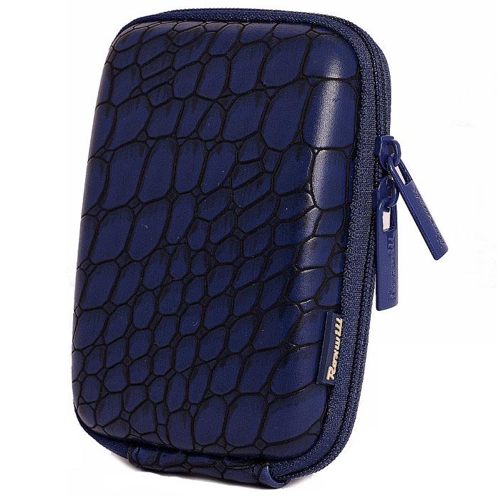 Roxwill C10 Croco, Blue чехол для фото- и видеокамерC10 croco blueRoxwill C10 Croco - стильный и надежный чехол для компактных фотокамер. Он гарантированно защитит вашу камеру от случайных ударов и царапин, а также от пыли и влаги. Изделие изготовлено из EVA (вспененная резина). Данный материал не подлежит воздействию агрессивных веществ и предохраняет фотоаппарат при падении. Для переноски предусмотрен регулируемый шейный ремешок и возможность крепления на поясном ремне.