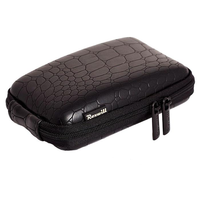 Roxwill C40 Croco, Black чехол для фото- и видеокамерC40 croco blackRoxwill C40 Croco - стильный и надежный чехол для компактных фотокамер. Он гарантированно защитит вашу камеру от случайных ударов и царапин, а также от пыли и влаги. Изделие изготовлено из EVA (вспененная резина). Данный материал не подлежит воздействию агрессивных веществ и предохраняет фотоаппарат при падении. Для переноски предусмотрен регулируемый шейный ремешок и возможность крепления на поясном ремне.