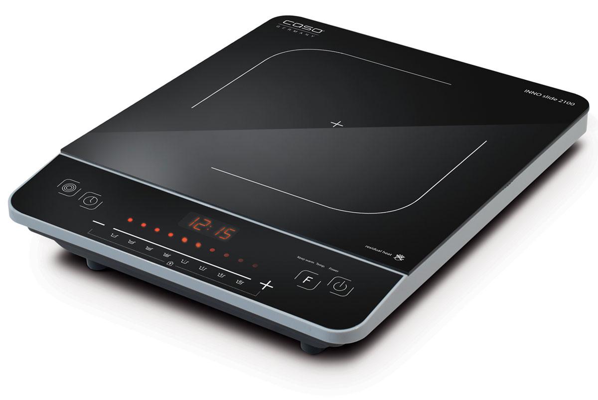 CASO Inno Slide 2100 настольная индукционная плиткаINNO Slide 2100Настольная индукционная плита CASO INNO Slide 2100 – верная помощница на кухне, которая служит качественно и долго и доставляет своему владельцу только положительные эмоции. Прибор имеет одну зону нагрева, сенсорное управление с дисплеем и светодиодной индикацией. Модель проста и понятна в настройке и управлении. Поверхность легко очищается от загрязнений. Варочная панель оснащена системой индукционного нагрева. Индуктор, расположенный под поверхностью, создает переменное электромагнитное поле – в результате этого в дне посуды индуцируется ток, что и приводит к нагреву. Тепло образуется непосредственно в дне посуды без промежуточного нагрева конфорки