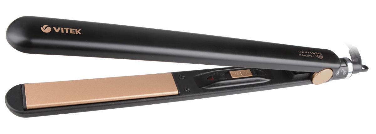 Vitek VT-2317 (BK) выпрямитель для волосVT-2317(BK)Выпрямитель для волос Vitek VT-2317 (BK) справится даже с самым непослушными волосами. Данная модель оснащена качественным керамическим турмалиновым покрытием пластин, а также функцией изменения температуры в зависимости от типа волос. Выпрямитель прост в использовании благодаря стильному эргономичному дизайну.Защита от перегреваИндикация включенияШирина пластин: 25 ммБлокировка ручки