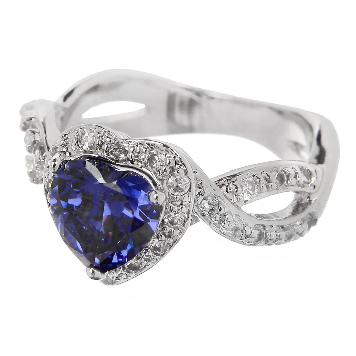 Кольцо Taya, цвет: синий, серебристый. Размер 18,5. T-B-4778Коктейльное кольцоВеликолепное кольцо Taya выполнено из гипоаллергенного металлического сплава на основе латуни с родиевым покрытием. Изделие дополнено цирконами. Такое кольцо станет украшением любого наряда. Кольцо подчеркнет вашу яркую индивидуальность и поможет создать неповторимый образ.