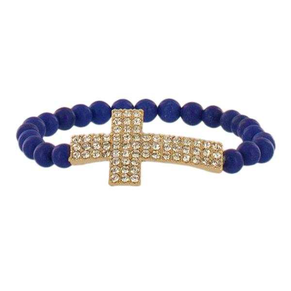 Браслет Taya, цвет: золотистый, синий. T-B-4501Браслет с подвескамиВеликолепный браслет Taya, изготовленный из гипоаллергенного материала, выполнен на эластичной основе из пластиковых бусин и дополнен декоративными металлическими элементами в виде подвески и крестика, инкрустированных стразами. Такой оригинальный браслет не оставит равнодушной ни одну любительницу изысканных и необычных украшений, а также позволит с легкостью воплотить самую смелую фантазию и создать собственный, неповторимый образ.