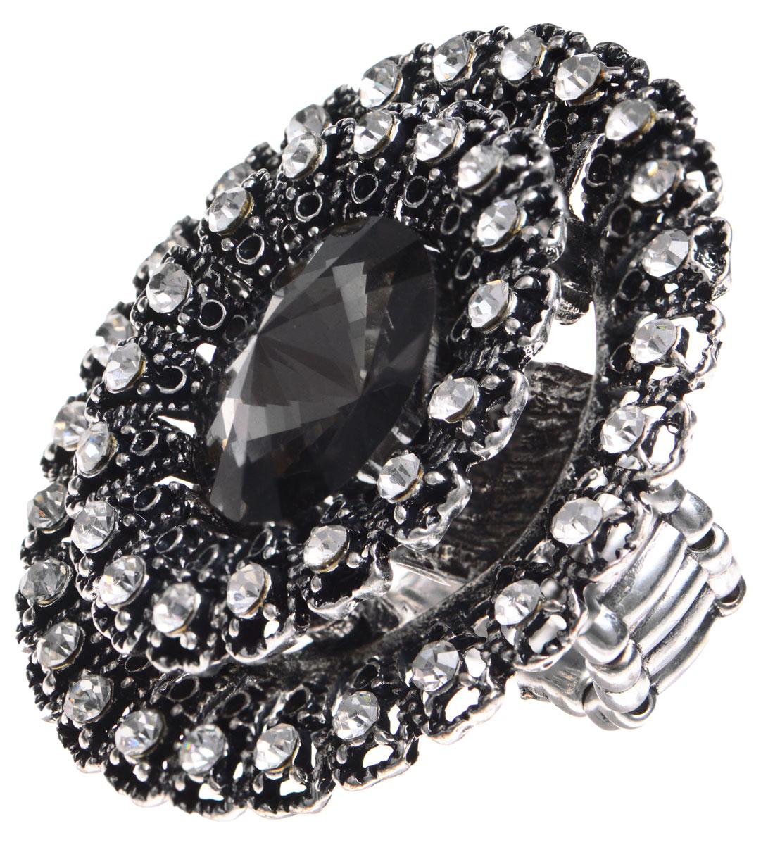 Кольцо Taya, цвет: серебристый. T-B-9264Коктейльное кольцоОригинальное кольцо Taya выполнено из бижутерийного сплава, дополнено декоративным элементом в виде цветка, каждый лепесток которого оформлен сверкающей вставкой из стекла. Сердцевина цветка украшена крупным граненым камнем.В основании изделия использована эластичная резинка, что делает размер кольца универсальным.Стильное кольцо придаст вашему образу изюминку, подчеркнет индивидуальность.