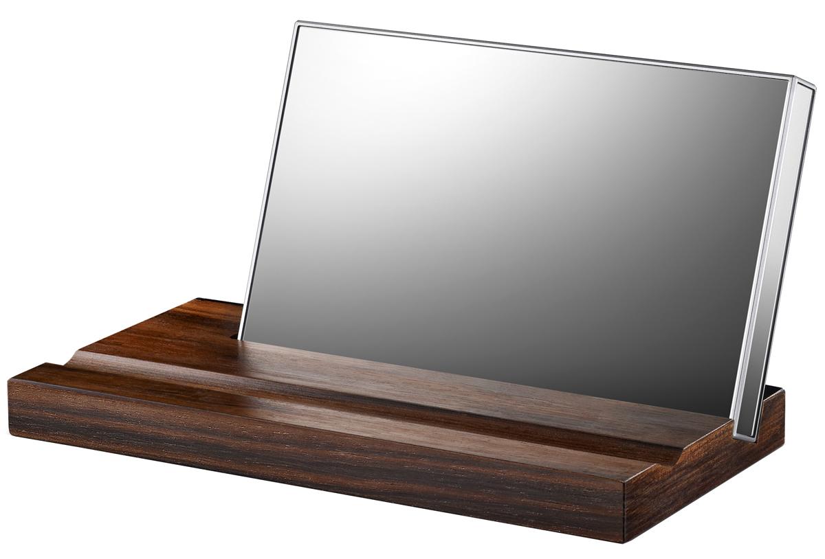 LaCie Mirror 1TB внешний жесткий дискLAC9000574LaCie Mirror - это портативный внешний жесткий диск, который компания LaCie разработала с известным французским дизайнером Полиной Дельтур. Жесткий диск имеет объем в 1 Тб, оснащен разъемом USB 3.0 и является отличным устройством для хранения цифровых фотографий, музыки, игр, фильмов и документов. Особенностью модели является корпус покрыт зеркальными панелями с удобной деревянной подставкой с подставкой из элитного черного дерева породы макассар, идущей в комплекте.Корпус жесткого диска выполнен из закаленного стекла Corning Gorilla Glass 3, который в сочетании с технологией дополнительного сопротивления повреждениям Native Damage Resistance (NDR), делает устройство еще более надежным. Со всех сторон корпус покрыт зеркальными панелями и высококачественной пластмассой на всех гранях устройства. Жесткий диск может устанавливаться на подставку из эбенового дерева в которой имеется две канавки, одна накопителя, а вторая для ручки или карандаша. С таким дизайном внешний жесткий диск LaCie Mirror Portable Hard Drive станет не только надежным хранилищем файлов, но и замечательным украшением рабочего стола.LaCie Mirror подключается к ПК через интерфейс USB 3.0 и имеет обратную совместимость для USB 2.0. Небольшой логотип LaCie рядом с портом USB, является индикатором питания, который светится белым цветом когда включен и мигает когда накопитель загружает какую-то информацию. Скорость передачи внешних данных составляет 500 Мб/с. Он имеет компактные размеры 2,5 и небольшой вес, что делает его отличным портативным устройством и дает возможность носить всегда с собой. Для более комфортной транспортировки в комплекте идет чехол.