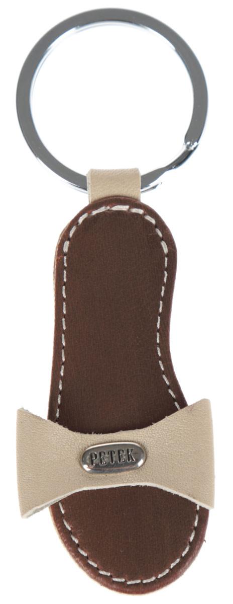 Брелок женский Petek 1855, цвет: коричневый, бежевый. 1517.000.041503.046.20 L.BeigeСтильный брелок для ключей Petek 1855 выполнен из натуральной кожи с декоративным тиснением. Брелок в виде туфельки оформлен небольшой металлической пластиной с гравировкой в виде логотипа производителя и оснащен металлическим кольцом. Изделие поставляется в фирменной упаковке. Брелок Petek 1855 порадует вас необычным дизайном и функциональностью, а также станет приятным подарком к любому празднику!