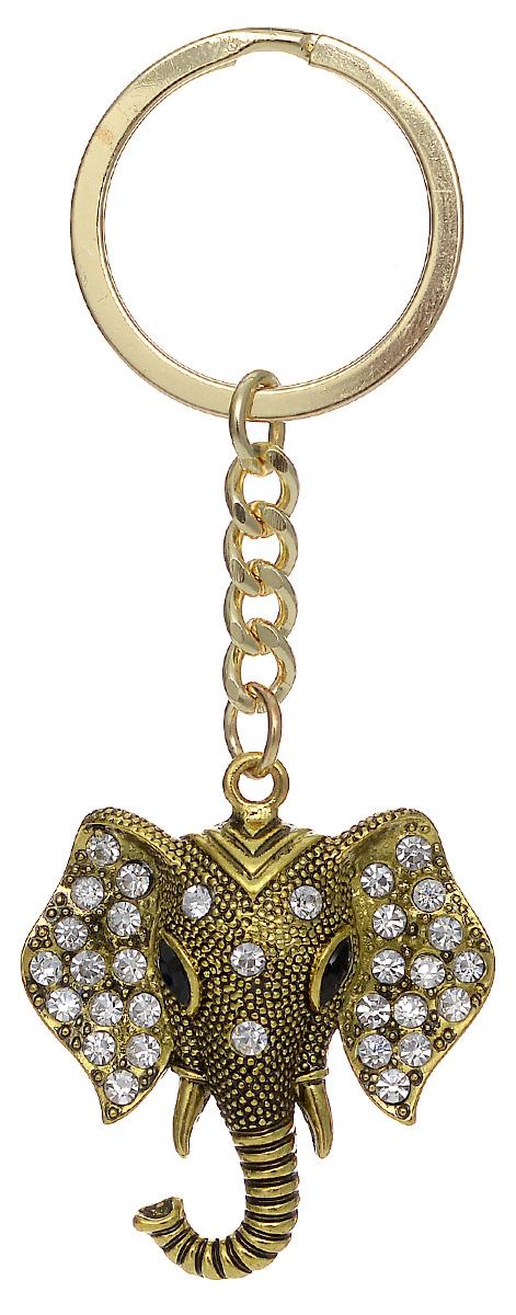 Брелок женский Mitya Veselkov, цвет: золотой. BRELOK-SLON-BLAБрелок для ключейОригинальный брелок для ключей Mitya Veselkov изготовлен из металла. Объемный декоративный элемент выполнен в виде головы слона, украшенной стразами. Замок брелока представлен в виде заводного кольца.Мелочей в образе не бывает, поэтому внимания требуют даже брелоки для ключей, ведь так приятно открывать дверь любимого дома ключом с красивым брелоком.