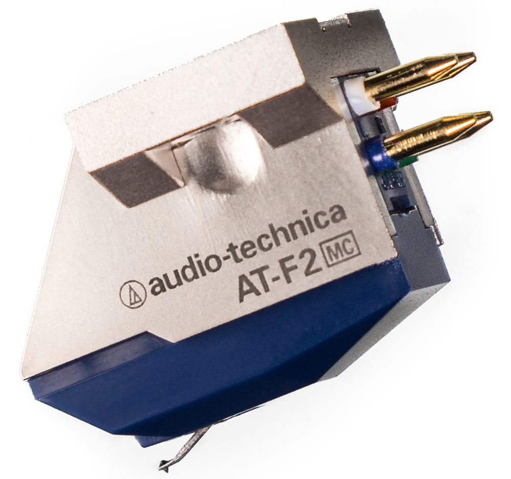 Audio-Technica AT-F2 головка звукоснимателя4961310127213Audio-Technica AT-F2 - высококлассный MC-звукосниматель с комбинированной конструкцией. Его основа выполнена с прецизионной точностью из алюминия, а основной корпус отлит из твердой смолы. Сочетание этих двух материалов позволяет практически полностью устранить паразитные резонансы и вибрации, и получить детализированный и прозрачный звук во всем диапазоне рабочих частот.Магнитная система Audio-Technica AT-F2 имеет перевернутую V-конструкцию с двумя катушками для левого и правого каналов, обладающую сниженной массой, что выразилось в уменьшении давления иглы на пластинку. Подобное техническое решение позволило также улучшить разделение стереоканалов, то есть сделать звуковую картину более натуральной и точной.Звукосниматель оснащен эллиптической алмазной иглой, изготовленной с высокой точностью в Японии, и зафиксированной в легкой и жесткой тонкостенной трубке из алюминия. В модели AT-F2 применены высокоэффективные неодимовые магниты, расположение которых выбрано таким образом, чтобы получить максимальную энергию поля в зоне расположения катушек. Последние выполнены из монокристаллической меди высокой степени очистки PCOCC, со сниженным сопротивлением и стабильными электрическими характеристиками.
