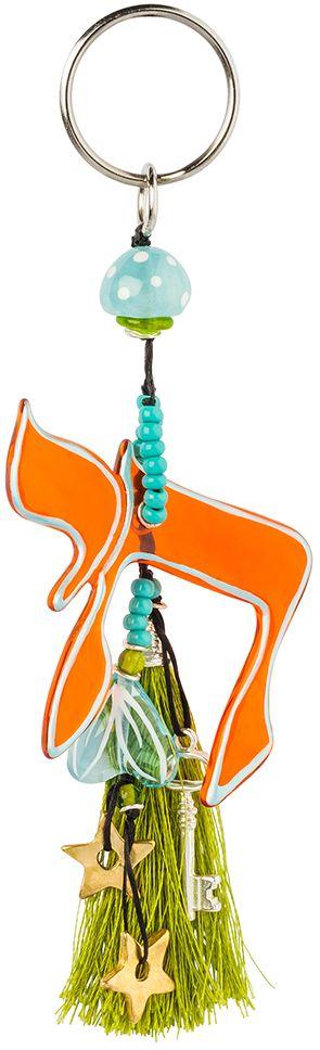 Брелок Lalo Treasures, цвет: красный, голубой, зеленый. KR4995Брелок для ключейБрелок Lalo Treasures изготовлен из ювелирной смолы ярких цветов и декорирован кисточкой из нитей с металлическим пояском. Изделие крепится к кольцу с помощью крепкого шнурка. Оригинальный брелок подчеркнет вашу индивидуальность, а также станет отличным подарком для любительниц модных новинок в мире аксессуаров.