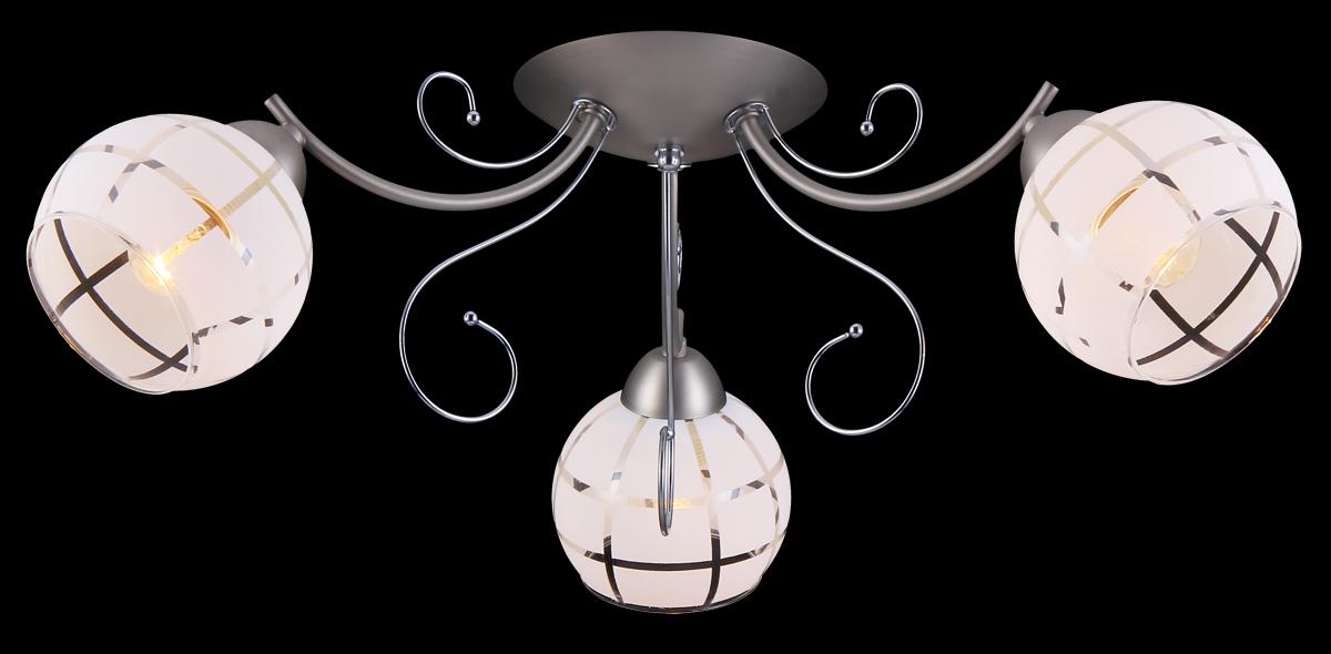 Люстра Natali Kovaltseva, 3 x E27, 60W. 11446/3C11446/3C NICKEL, CHROMEЛюстра Natali Kovaltseva, выполненная в классическом дизайне, станет украшением вашей комнаты и изысканно дополнит интерьер. Изделие крепится к потолку. Такая люстра отлично подойдет для освещения кабинета, столовой, спальни или гостиной. Люстра выполнена из металла с матовым никелированным покрытием, отдельные элементы имеют хромированное покрытие. Изделие оснащено 3 плафонами из матового стекла, украшенными прозрачными полосами. В коллекциях Natali Kovaltseva представлены разные стили - от классики до хайтека. Дизайн и технологическая составляющая продукции разрабатывается в R&D центре компании, который находится в г. Дюссельдорф, Германия. При производстве продукции используются высококачественные и эксклюзивные материалы: хрусталь ASFOR, муранское стекло, перламутр, 24-каратное золото, бронза. Производство светильников соответствует стандарту системы менеджмента качества ISO 9001-2000. На всю продукцию ТМ Natali Kovaltseva распространяется гарантия.