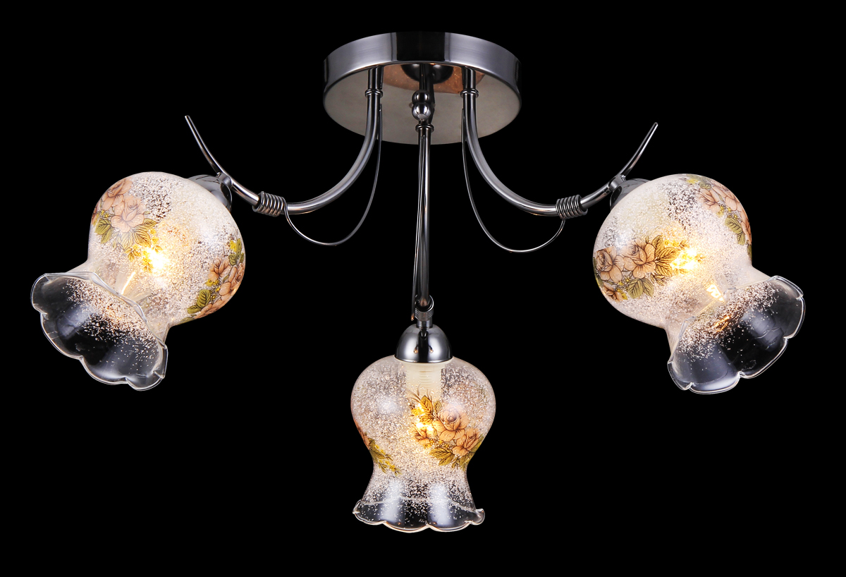 Люстра Natali Kovaltseva, 3 x E14, 60W. 11450/3C11450/3C CHROMEЛюстра Natali Kovaltseva, выполненная в классическом дизайне, станет украшением вашей комнаты и изысканно дополнит интерьер. Изделие крепится к потолку. Такая люстра отлично подойдет для освещения кабинета, столовой, спальни или гостиной. Люстра выполнена из металла с хромированным покрытием и оснащена 3 плафонами из стекла с декоративным напылением. Плафоны выполнены в форме бутонов цветка и украшены цветочным рисунком. В коллекциях Natali Kovaltseva представлены разные стили - от классики до хайтека. Дизайн и технологическая составляющая продукции разрабатывается в R&D центре компании, который находится в г. Дюссельдорф, Германия. При производстве продукции используются высококачественные и эксклюзивные материалы: хрусталь ASFOR, муранское стекло, перламутр, 24-каратное золото, бронза. Производство светильников соответствует стандарту системы менеджмента качества ISO 9001-2000. На всю продукцию ТМ Natali Kovaltseva распространяется гарантия.
