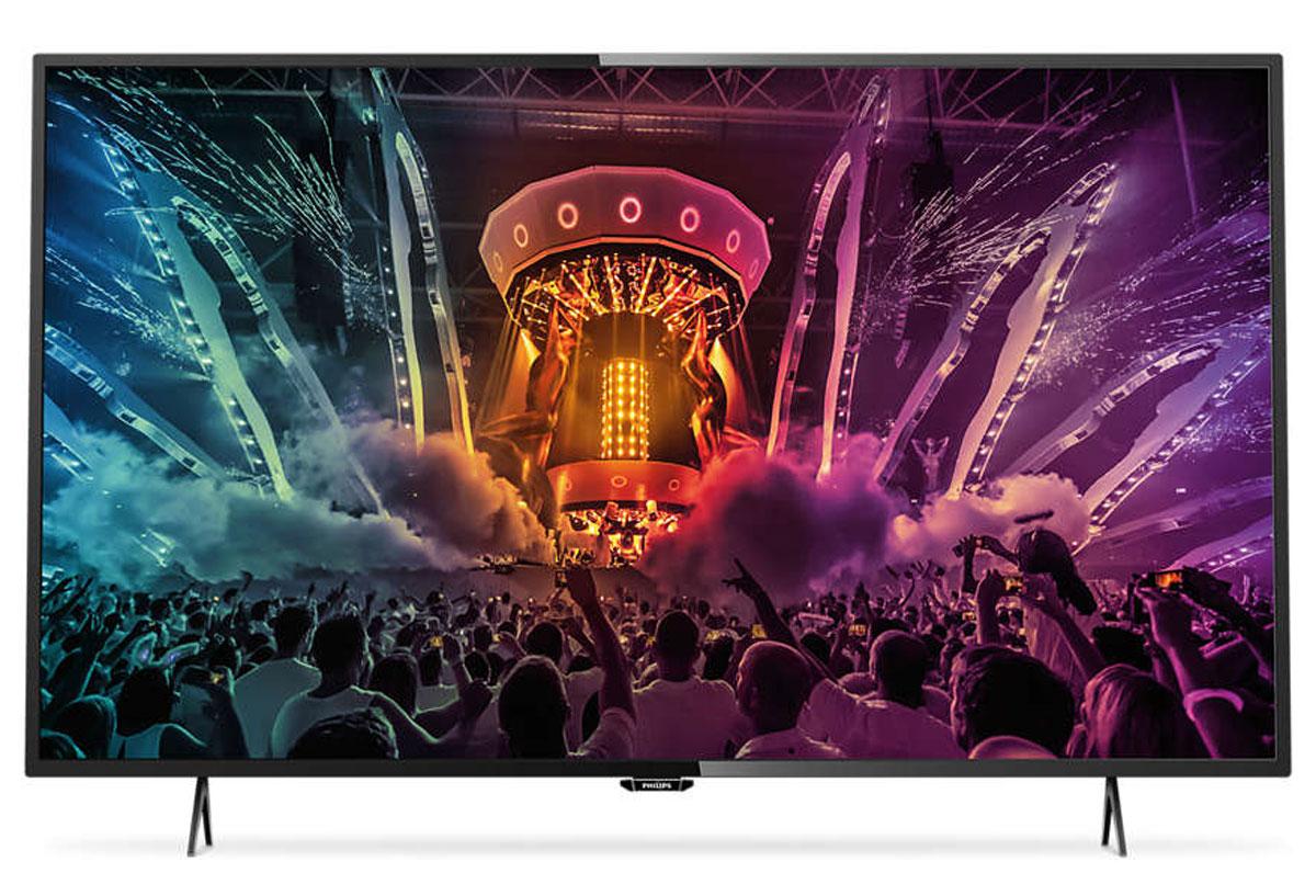 Philips 49PUT6101, Black телевизор49PUT6101/60Утонченные линии подчеркивают изящность дизайнаИзящный, современный, лаконичный дизайн. Неудивительно, что ультратонкий силуэт телевизора Philips 49PUT6101 притягивает к себе взгляд — это идеальное решение, которое прекрасно дополнит любой интерьер.4K Ultra HD: непревзойденное качество изображения в высоком разрешенииТелевизор Philips 49PUT6101 Ultra HD в 4 раза превосходит разрешение обычного телевизора Full HD. Благодаря 8 миллионам пикселей и уникальной технологии Ultra Resolution качество изображения не будет зависеть от исходного контента. Улучшенная четкость и глубина изображения, великолепный контраст, плавное и естественное движение и безупречная детализация.Smart TV: исследуйте для себя совершенно новый мирОткройте для себя интеллектуальные возможности этого телевизора. Настраивайте потоковую передачу фильмов, видео или игр, приобретая их в онлайн-магазинах. Просматривайте прошедшие передачи с любимых телеканалов и наслаждайтесь широким выбором интернет-приложений в Smart TV.Технология Micro Dimming оптимизирует контрастность изображения на экране телевизораБлагодаря нашему специализированному ПО, которое анализирует 6400 областей изображения и адаптирует его к текущим условиям, вы сможете насладиться высококонтрастным, качественным и невероятно реалистичным изображением.Сверхтонкие стальные подставки в темно-серебристом цветеПотрясающий дизайн сверхтонкой подставки в темно-серебристом цвете создает ощущение, будто новый телевизор Philips 49PUT6101 парит в воздухе. Для ее создания разработчики использовали тщательно обработанную сталь высокого качества и отделку в футуристическом стиле.Насладитесь качеством изображения Ultra HD с Pixel Plus Ultra HDПроцессор Philips Pixel Plus Ultra HD оптимизирует качество изображения и обеспечивает плавную передачу сцен с невероятной детализацией и глубиной. Вы всегда будете наслаждаться четким изображением 4K с яркими оттенками белого и глубокими оттенками черного.