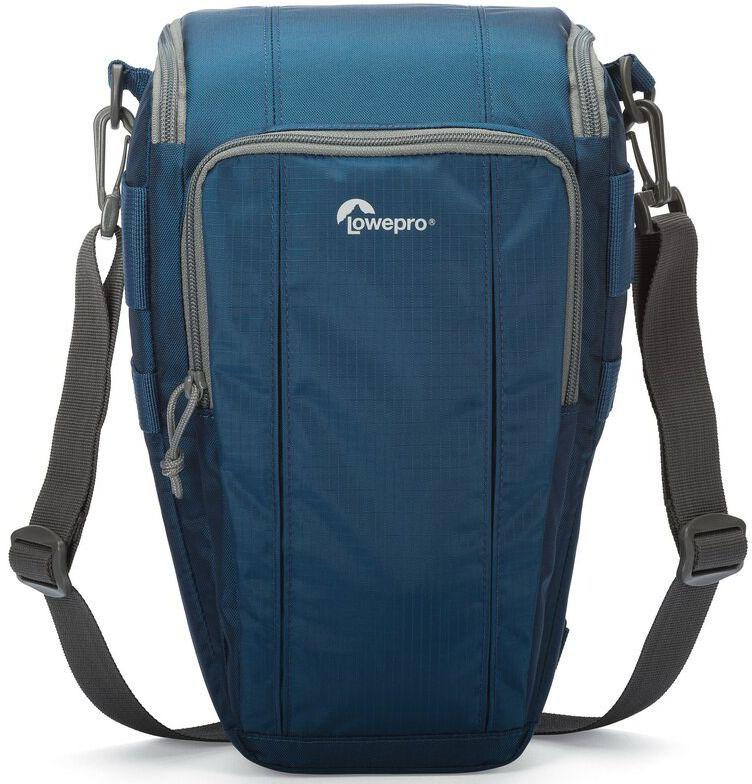 Lowepro Toploader Zoom 55 AW II, Blue сумка для фотокамерыLP36705-0RUВторое поколение сумок серии Toploader Zoom AW II предоставляют надежную защиту в течения дня на прогулке, в путешествие или при спортивной съемке. Компактные, оснащенные возможностью быстрого доступа к камере сумки, которые можно носить тремя способами (на плече, поясе или с помощью специальной разгрузочной системы Topload Chest Harness). Бегунки застежек-молний, которые легко открываются и закрываются при низких температурах, имеют специальные D-образные кольца: их просто нащупать, за них легко ухватиться. На светло-серой ткани отделки основного отсека сумок быстрее можно разглядеть нужную вещь.Все сумки серии оснащены встроенным всепогодным защитным чехлом All Weather AW Cover и вместительным фронтальным карманом на молнии для разных полезных мелочей, кошелька или документов