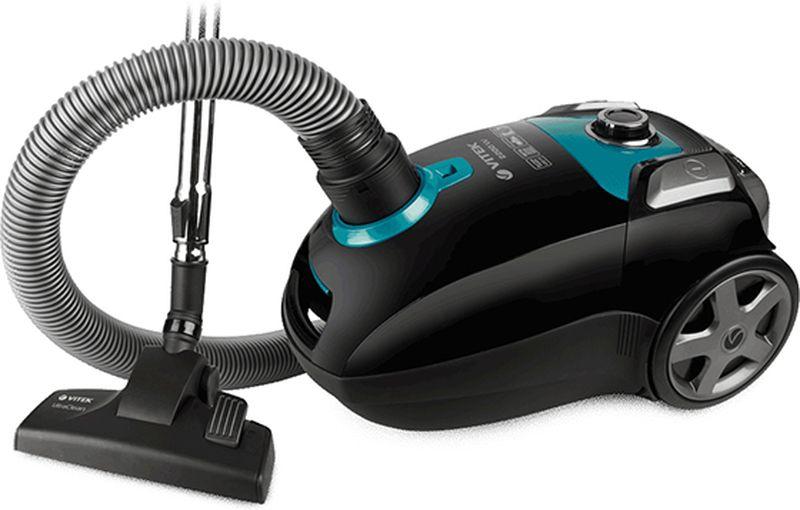 Vitek VT-1898 BK пылесосVT-1898(BK)Пылесос VT-1898 BKстанет настоящим подспорьем, если вы планируете генеральную уборку дома.Отличительной особенностью данной моделиявляетсяширокое отверстиедля всасываниявоздуха – 45 мм и низкий уровень шума. Устройство работает практически беззвучно: уровень шума составляет всего 69 дБ.Бесшумный пылесос VT-1898 BK от VITEKпозволит наводить порядок в помещении с максимальным комфортом для себя и окружающих. Онсохраняет тишину и покой в доме.Такой пылесос оснащен уникальной системойHEPA-фильтров, которая эффективно «борется» за идеальную чистоту в вашем доме: благодаря 5-ступенчатой системе фильтрации пылесос задерживает споры, пепел, пыльцу, бактерии и микроскопические частички пыли размером от 0,3 мкм и больше. Это особенно важно, когда в доме есть дети и люди, страдающие аллергией или астмой: такая тщательная уборка позволяет избежать раздражений органов дыхания.Пылесос VT-1898 BK обеспечен пылесборником емкостью 4,0 л., который не потребует частой замены.Дополнительный тканевый мешок для сбора пыли прилагаетсяв комплекте.Регулировать мощность в зависимости от типа уборки вам поможет удобно расположенный на корпусе пылесоса переключатель. Также в данной модели пылесоса для вашего удобства предусмотрена функцияавтоматического сматывания шнура. Нажатием соответствующей клавиши шнур втягивается внутрь корпуса пылесоса, что значительно облегчает сматывание шнура после уборки. Работа с пылесосом особенно удобна благодаря стальнойтелескопическойтрубке, которую можно легко настроить на нужную длину и зафиксировать в таком положении.