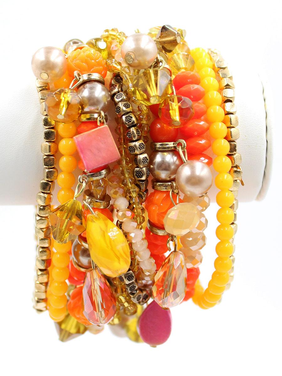 Браслет Taya, цвет: золотистый, оранжевый. T-B-11753-BRAC-GL.ORANGEГлидерный браслетШирокий браслет из стеклянных бусин разнообразной огранки в сочетании с плетеной нитью из бисера выглядит броско и стильно. Магнитная застежка - удобное и современное решение, которое исключает случайное открытие и потерю браслета.