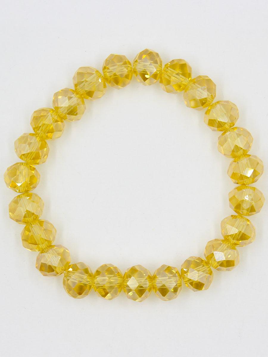 Браслет Taya, цвет: золотистый. T-B-11791-BRAC-GOLDБраслет с подвескамиУниверсальный однотонный браслет на резинке. Огранка кристаллов идеальная. они ярко искрятся под любым освещением.