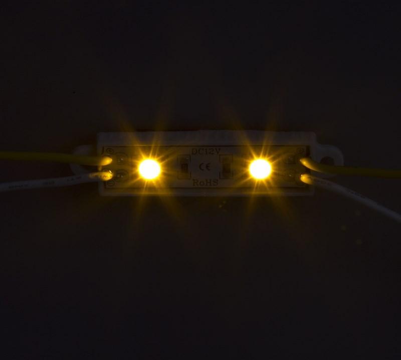 Модуль светодиодный, IP67 влагозащищенный, 2 SMD 5050 LED, ЖЕЛТЫЙ141-402Светодиодные модули. При помощи светодиодных модулей изготавливаются объемные буквы, различные световые короба, декоративная подсветка интерьера, фасадное освещение. Наметилась тенденция к замене светодиодными модулями неона во внутренней подсветке больших букв. При их использовании отпадает надобность в установке каждого светодиода по отдельности, поэтому время на монтаж существенно сокращается. Это стало причиной отказа от применения локальных светодиодов в пользу модулей. В нашем каталоге представлены все возможные варианты светодиодных модулей, включающие от 2-х до 6 диодов всех основных цветов. Светодиодный модуль может служить свыше 50 000 часов, а энергии он потребляет почти в 10 раз меньше, чем лампы накаливания. Применение таких приборов ведет к заметной экономии электроэнергии.