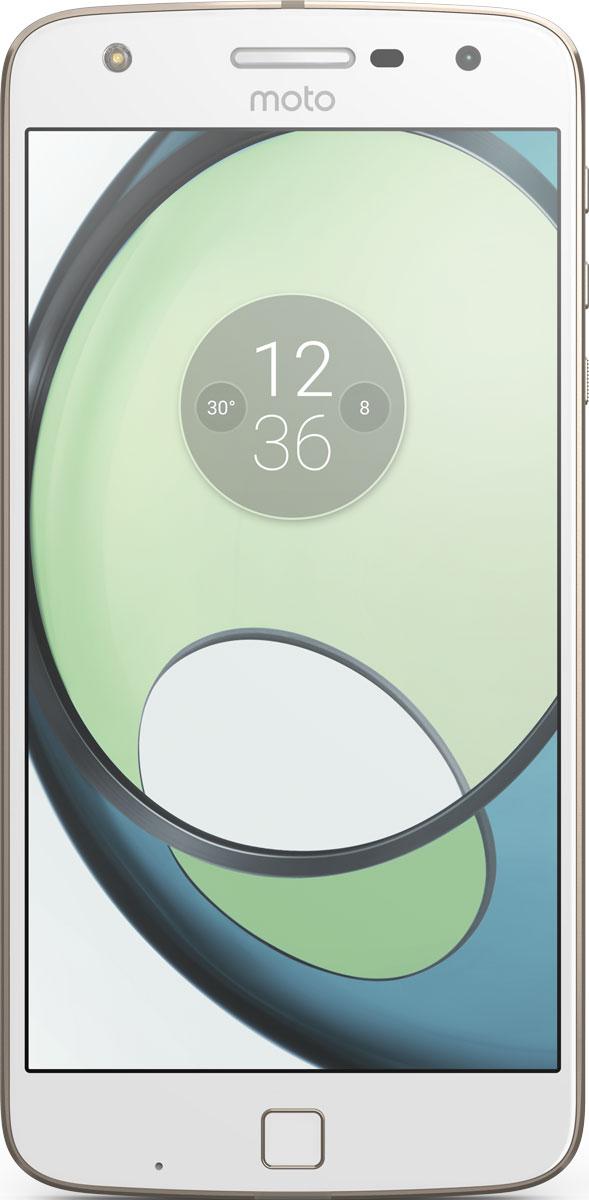 Moto Z Play, White GoldSM4425AD1U1Moto Z Play. Превосходный аккумулятор. Неограниченные возможности.Модули Moto Mod открывают новые возможности использования телефона. Воплощай свои фантазии при помощи сменных задних панелей, которые крепятся к телефону на мощных встроенных магнитах. Чтобы ты ни задумал, всегда найдется подходящая панель Moto Mod.Что может быть хуже, чем поиск электрической розетки для подзарядки телефона уже после нескольких часов использования? К счастью, Moto Z Play может работать от аккумулятора до 50 часов - ты сможешь продолжить заниматься своими делами без подзарядки телефона.Время драгоценно. Не трать его на подзарядку своего смартфона. Всего несколько мгновений на зарядке, и можно продолжить движение. Функция быстрой зарядки TurboPower обеспечит до 10 часов автономной работы твоего устройства всего за 15 минут подзарядки.Благодаря камере 16 Мпикс и двум дополнительным системам автофокуса Moto Z Play позволяет делать четкие фотографии гораздо быстрее. Высокая скорость работы лазерного и фазового (PDAF) автофокуса дает возможность не упустить отличный кадр - неважно, днем или ночью.На снимках, сделанных фронтальной пятимегапиксельной камерой с широкоугольным объективом, поместятся все твои друзья. Благодаря дополнительной вспышке на передней панели каждый будет выглядеть превосходно, даже при плохом освещении.Moto Z Play оснащен превосходным 5,5-дюймовым Full HD-дисплеем Super AMOLED 1080p в тонкой металлической рамке. Он подарит прекрасное качество изображений - яркие оттенки и интригующие детали в фото, видео и играх прекрасно дополняют стильный корпус смартфона.Играй, смотри потоковое видео и открывай несколько приложений одновременно без малейшего промедления. Восьмиядерный процессор 2,0 ГГц в паре с 3 ГБ быстрой оперативной памяти обеспечивает плавную работу и сможет справиться с любой задачей.Запомнить пароль бывает непросто. Что ж, запомнив отпечатки твоих пальцев, Moto Z значительно упростит твою жизнь. Это позволит мгновенно и безопа