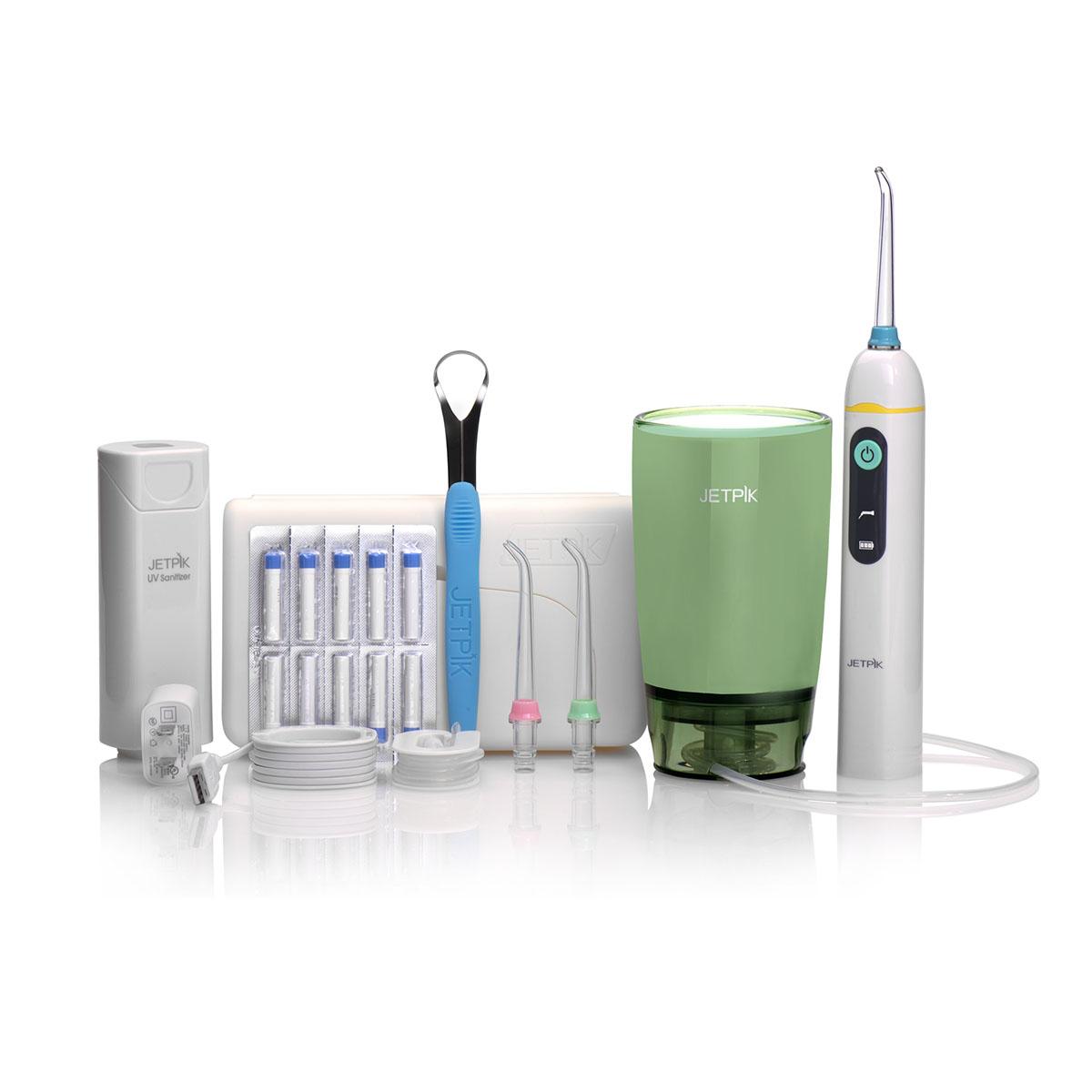 Ирригатор полости рта Jetpik JP50-UltraJA05-104-02Сочетает в себе очищающее действие зубной нити (смарт-флосса), воды и воздуха. Легкий в использовании, очень эффективный и экономит время. Здоровые десны и чистые зубы уже через 7 дней. Клинически доказано, что удаляет до 99% зубного налета Инновационная комбинация давления воды и пульсирующей флосс- системы (20-25 колебания в сек) удаляет остатки пищи глубже и быстрее, между зубами и ниже линии десен, в труднодоступных местах вокруг брекетов, между зубными имплантатами и коронками. Пульсирующая под давлением воды смарт флосс- система создает дополнительную силу трения. Лабораторно доказано что JETPIK на 240% более эффективно удаляет зубной налет и биопленку, чем обычные водные ирригаторы. Эффективный, безопасный и простой в использовании. Идеально подходит для тех, кто с имплантатами, коронками, брекет-системами, мостовидными протезами, пародонтальными карманами. Портативный и компактный - по размерам не больше электрической зубной щетки, благодаря встроенной литиевой батарее заряжается как мобильный телефон через базовое зарядное устройство или USB разъем. Как жидкость для ирригации можно использовать не только воду, но и лечебные растворы. Удобный специальный стакан JETPIK или любая емкость подойдет как резервуар, благодаря портативной силиконовой клипсе JETPIK, которая идет в комплекте с набором. Уникальное дезинфицирующее средство, чтобы уничтожить бактерии на зубной щетке и насадках (UV санитайзер). Мощность 200-550 кПа.