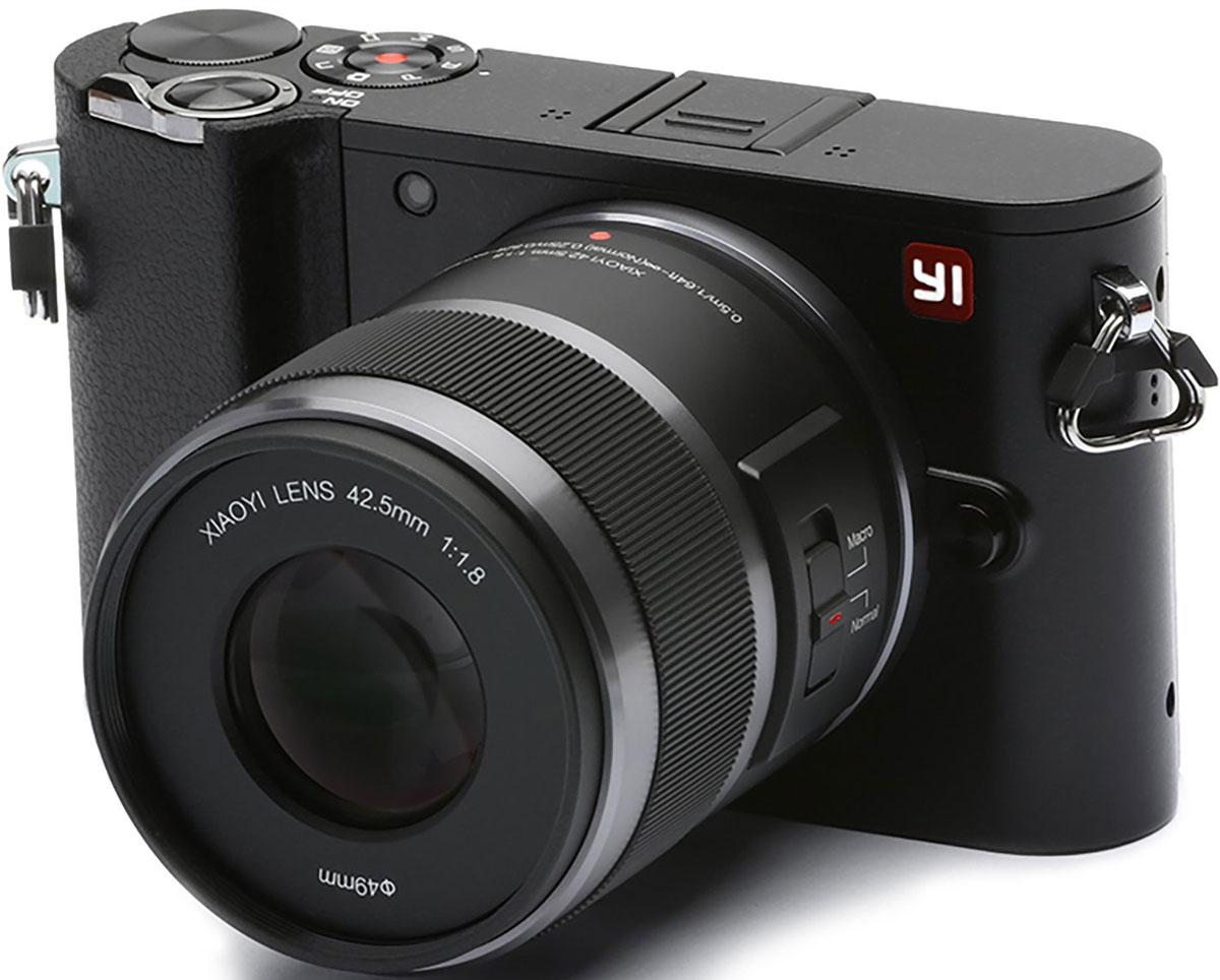 Xiaoyi Yi M1 42.5mm F/1.8, Black цифровая фотокамера95015Беззеркальная цифровая камера Xiaoyi Yi M1 обеспечивает потрясающие фото благодаря использованию сенсору IMX269 от компании Sony с точной цветопередачей.Разрешение матрицы Yi M1 составляет 20 эффективных мегапикселей, на данных момент это отвечает самым высоким требованиям в стандарте крепления объектива Микро 4:3 (MFT), что гарантирует точную цветопередачу и высокую резкость изображения.Возможность записи видео в разрешение 4K со скоростью 30 кадров в секунду позволит оживить вашу фотографию и наполнить её жизнью!В меню настроек вы найдете основные параметры и дополнительные настройки, расширяющие ваши возможности. Автоматическая настройка: съемка, фокус, цвет, диафрагма, затвор, ISO, экспозиция, экспозамер, баланс белого.Скачайте приложение Master Guide на ваш телефон. Синхронизируйте фотоаппарат с вашим телефон для мгновенного доступа к фото. Технология Bluetooth устанавливает надежное соединение между камерой и телефоном. Wi-Fi автоматически включается для быстрого скачивания фото с вашей камеры, что позволяет поделиться вашими только что сделанными кадрами.Байонет MFT универсален и креативен. Он не зря выбран стандартом для беззеркальных камер со сменными объективами, фотоаппарат Yi M1 с этим байонетом компактен, отлично снимает, и достиг баланса в портативности и качества съемки. Выбор из более чем 50 объективов добавляет вам возможность выбрать объектив под себя. Настройте камеру под себя, выберите нужный объектив.Вес снаряженной камеры с аккумулятором без объектива составляет всего лишь 280 грамм. Почувствуйте свободу творчества с наиболее продвинутой операционной системой в сочетание с изысканным дизайномОдно из главных достоинств камеры – минималистический дизайн для простоты и удобства в использование. Ручное управление – просто и быстрое.Откажитесь от сложности и опробуйте простоту с Yi M1. Сконцентрируйтесь на творчестве с управлением сенсорным экраном и меньшим количеством механических кнопок.