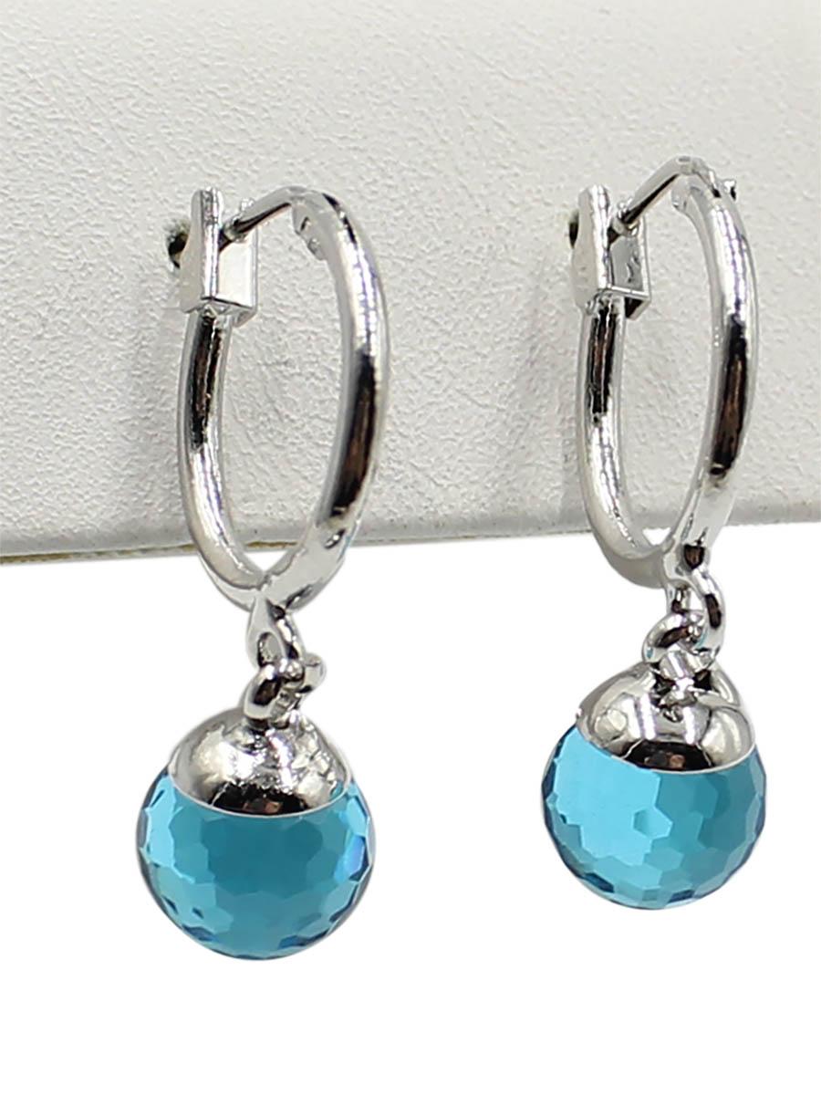 Серьги Taya, цвет: серебристый, синий. T-B-12383Серьги с подвескамиСерьги с итальянской застежкой изготовлены из бижутерного сплава. Классические серьги-кольца с подвеской. Подвеска оформлена в виде сияющего кристалла.
