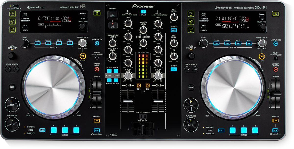 Pioneer XDJ-R1 DJ контроллер344942Pioneer XDJ-R1 - DJ контроллер с возможностью беспроводного управления.Это комбинированная конструкция из двух плееров и микшера c внушительными характеристиками. XDJ-R1 можно управлять с помощью беспроводных технологий с iPad, iPhone или iPod Touch, подключившись к собственной беспроводной локальной сети XDJ-R1. Просматривайте с сенсорного экрана музыку, создавайте миксы, делайте поппури из треков — для этого не обязательно находиться в непосредственной близи с контроллером. Все необходимые для диджея возможности собраны в одном портативном устройстве.Pioneer XDJ-R1 воспроизводит музыку с самых разных источников, таких как CD, USB, PC, Mac и iOS-устройства.Вы можете просматривать свое rekordbox устройство,загружать музыку, управлять эффектами, параметрами, деками, делать лупы и пользоваться CUE-метками — достаточно установить приложение remotebox.На каждом канале присутствует Sound Color Filter, что позволяет выполнять динамическую аранжировку и микширование, добавляя эффекты.Сенсорное управление XDJ-R1 предоставляет неограниченные возможности для живых выступлений: два сенсорных джога для точного скретчинга, двухканальный микшерный пульт, а также назначенные кнопки для создания петель, меток, запуска семплов иэффектов студийного качества.DJ-R1 оснащен Master Out (XLR), Booth Out, Aux и Mic для подключения к внешним аппаратным и профессиональным звуковым системам. Микшер можно подключить к виниловым проигрывателям и CDJ-плеерам и использовать в качестве автономного пульта.DJ контроллер позаимствовал звуковую систему из профессиональной линейки, включая встроенную 44.1 кГц/24-битную звуковую карту и высокопроизводительный процессор.Pioneer XDJ-R1 готов к работе сразу после распаковки, нет необходимости в дополнительном оборудовании и коммутировании. Унифицированное устройство поддерживает воспроизведения через USB, CD, имеет на борту два сенсорных джога, двухканальный микшер, а также эффекты и рабочие характеристики, позаимствованны
