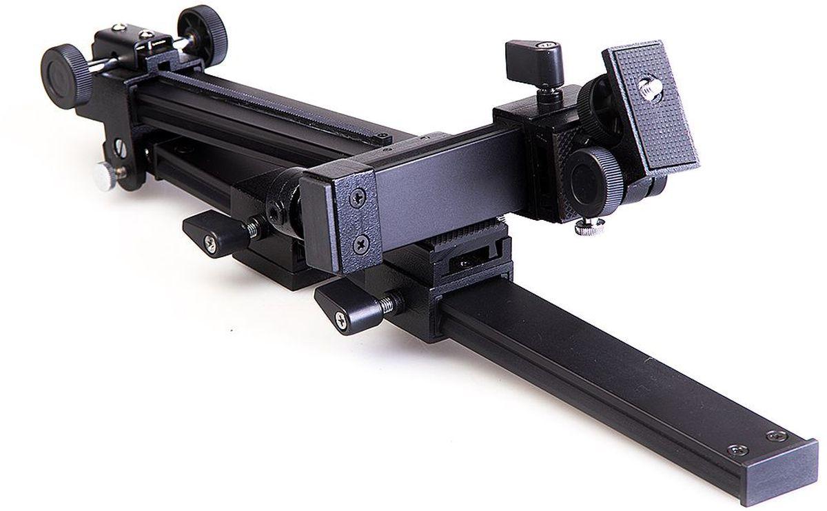 Кронштейн к зрительной трубе Veber. 1110311103Универсальный кронштейн, предназначенный для сопряжения фотоаппарата со зрительной трубой. ОПИСАНИЕУниверсальный кронштейн, предназначенный для сопряжения фотоаппарата со зрительной трубой. Кронштейн изготовлен из силумина, он имеет максимально возможное количество подвижек для точной установки камеры, относительно окуляра зрительной трубы.Отличительная особенность:Обычно зрительная труба устанавливается непосредственно на штатив. При этом возникает риск повреждения зрительной трубы при случайном нажатии на «объективную» часть, что особенно опасно для больших зрительных труб (возникает большой «рычаг» и выламывается узел крепления трубы на штативе или головка штатива). В данной конструкции узел крепления трубы на штативе крепится сначала к подвижной площадке на горизонтальной направляющей нашего кронштейна, после чего уже эта горизонтальная направляющая крепится к головке штатива. Возникают две точки опоры, риск повреждения самой зрительной трубы исключен. Вертикальная направляющая кронштейна имеет максимум регулировок для точной установки оси объектива фотоаппарата относительно оси окуляра зрительной трубы.Фотоаппарат крепится на поворотной площадке, т. е. вы имеете возможность наблюдения в зрительную трубу, а при необходимости сделать снимок — просто приводите аппарат на поворотной площадке в положение «для съемки» (заранее установленное).Комплектация Кронштейн фотоаппарат - зрительная труба Veber Инструкция по эксплуатации Гарантийный талонХарактеристикиРасстояние от штативного крепления зрительной трубы до вертикальной рейки, макс., мм 360Высота установки камеры на вертикальной рейке, мм от 105 до 260Ход движения планки крепления фотоаппарата, мм 70Угол наклона поворотного кронштейна,° +120/-45Размер площадки крепления зрительной трубы, мм 39x32Размер площадки крепления фотоаппарата, мм 45x22Материал металлГабаритные размеры, мм 410x160x90Вес, г 910